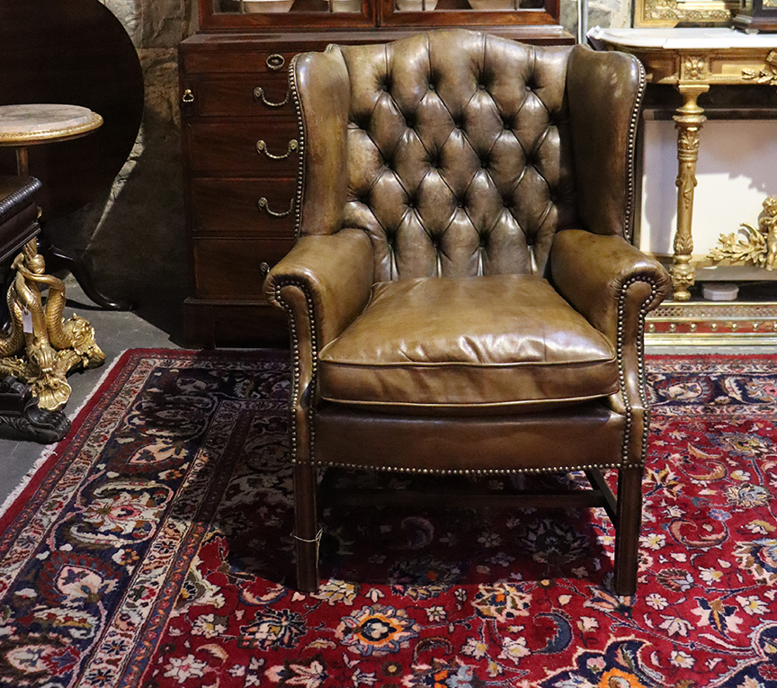 Pair of Deep-buttoned Leather Wingback Chairs